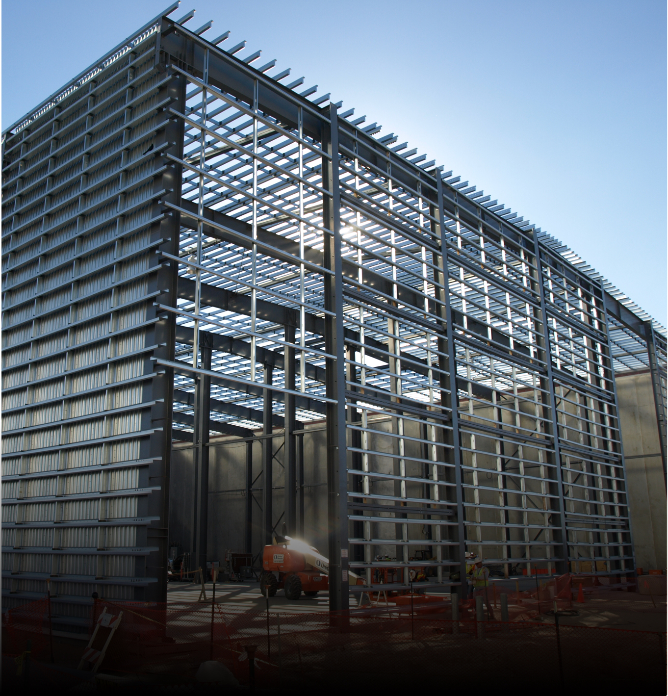Construction view of steel frame industrial building designed in Texas by commercial contractors